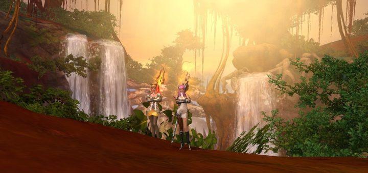 """Bild 1. Hier sehen wir einen Screenshot aus dem Spiel """"Aion"""", bei dem alle Chats und andere Einblendungen deaktiviert sind. Hier sehen wir zwei Figuren vor Wasserfällen, die zu einer der Welten in """"Aion"""" gehören. Die Figuren stehen zusammen, während die Spieler*innen sich im spielexternen Sprachchat über die Kulisse und die nächsten Kämpfe austauschen."""